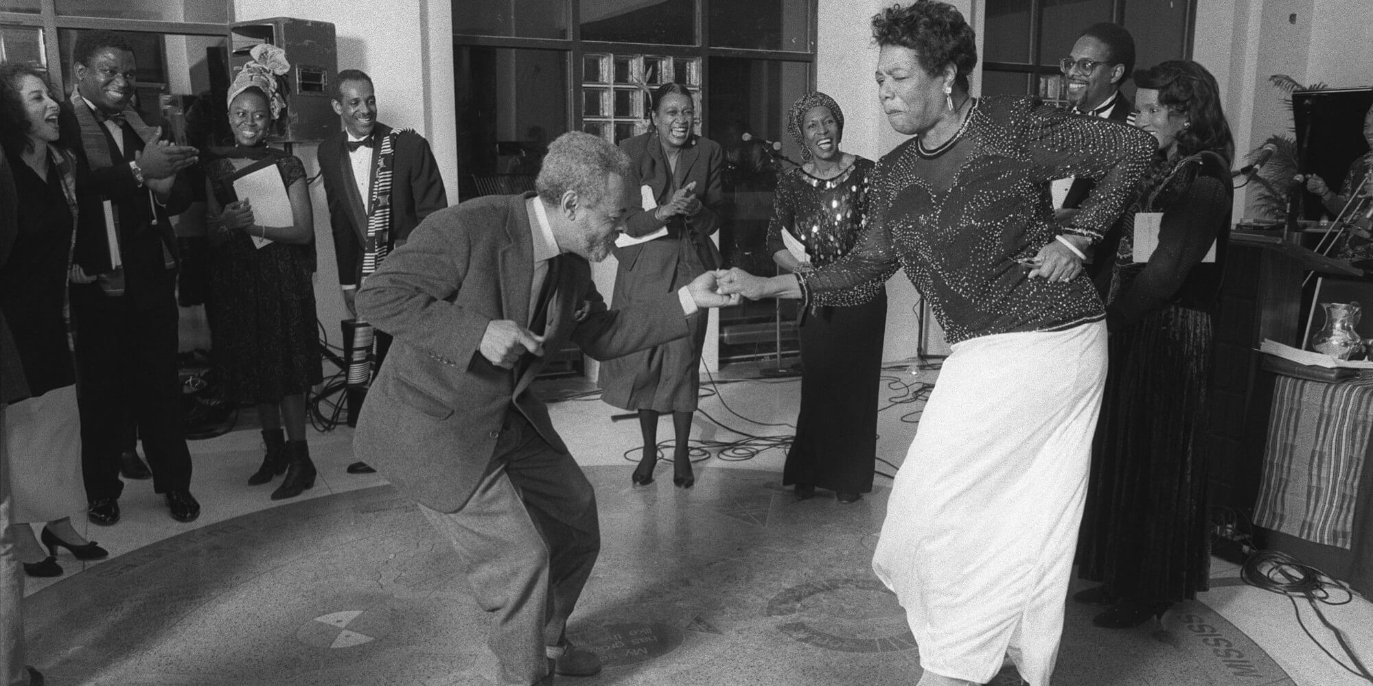 FILE -- Amiri Baraka and Maya Angelou dance on the 89th birthday of the poet Langston Hughes at the The Schomburg Center for Research in Black Culture, where Hughes' ashes were buried beneath the floor, in New York, Feb. 22, 1991. Baraka, a poet and playwright of pulsating rage, whose long illumination of the black experience in America was called incandescent in some quarters and incendiary in others, died Jan. 9, 2014. He was 79. (Chester Higgins, Jr./The New York Times)